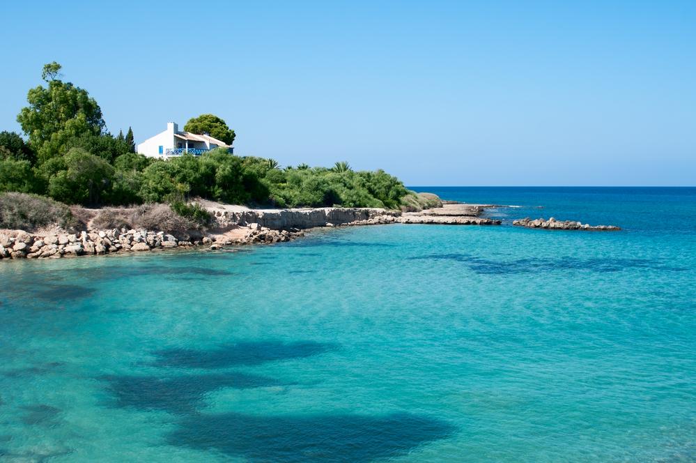Small house on seashore of Cyprus Island near Mediterranean sea