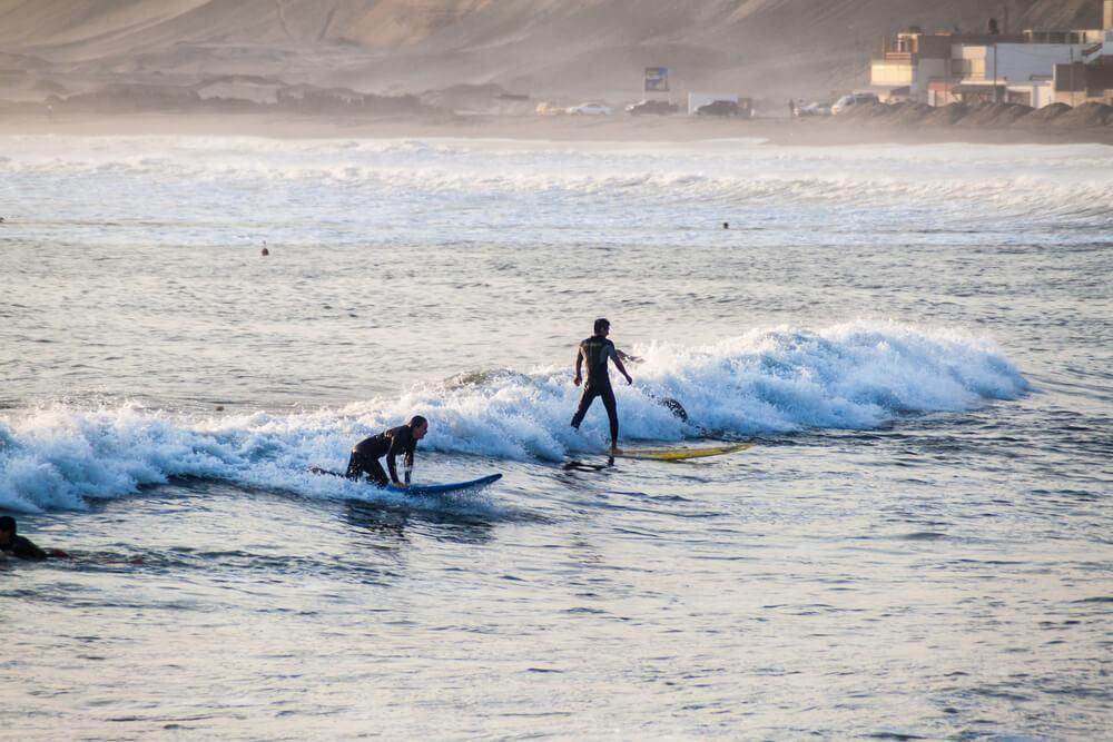 Surfing in Huanchaco, Peru.